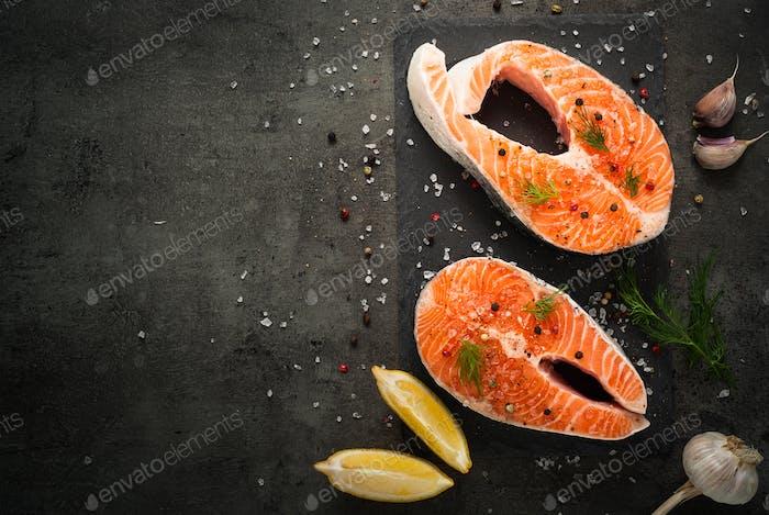 Raw salmon steak with food ingredients