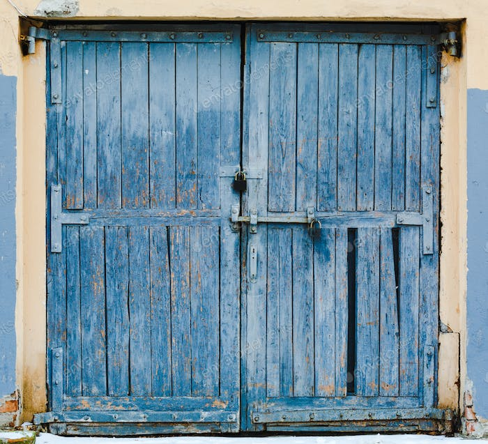Old large wooden doors painted in blue