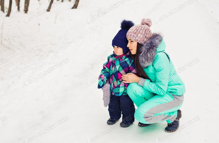 Mother and child enjoying beautiful winter day outdoors