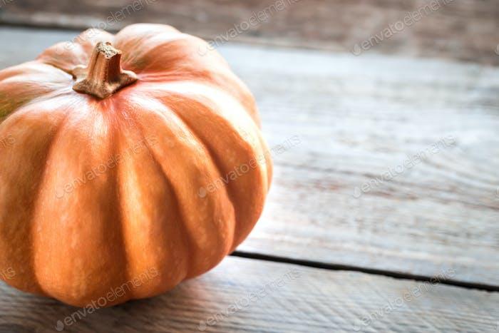 Pumpkin on the wooden background