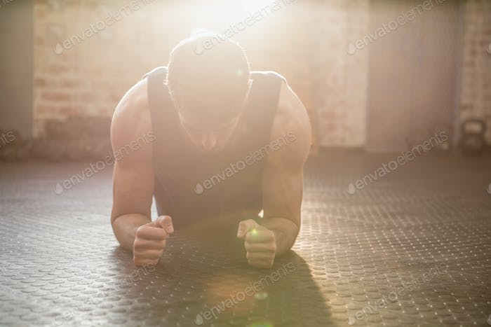 Man doing plank exercise at the gym