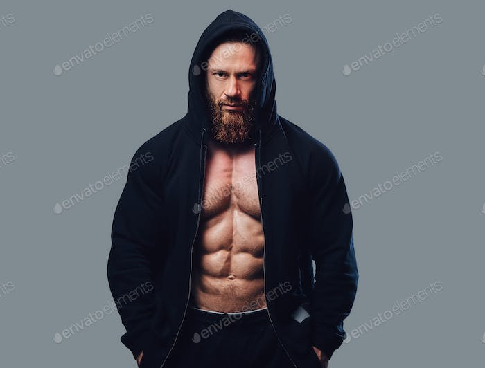 Bodybuilder in a black jacket with a hood.
