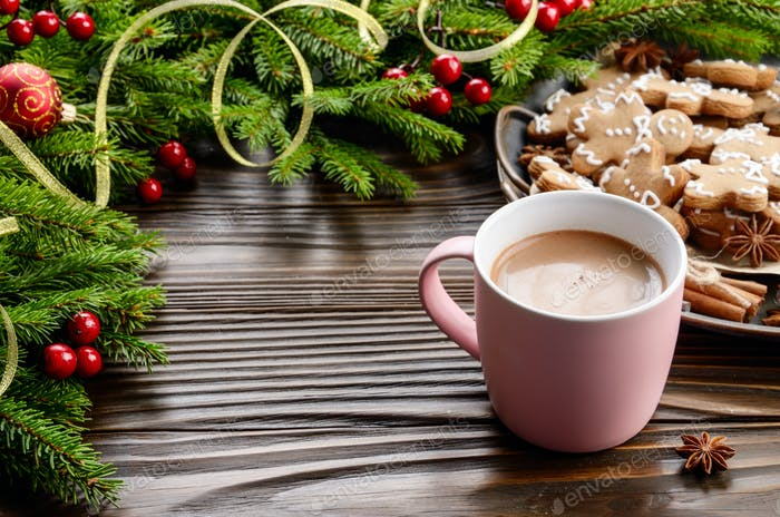 Christmas background of pink mug with hot chocolate, spruce bran