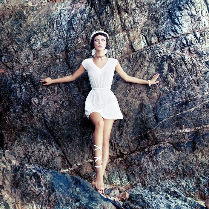 sensual girl on the rocks