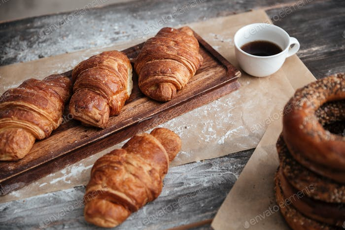 Cropped image of a lot of pastries croissants on table