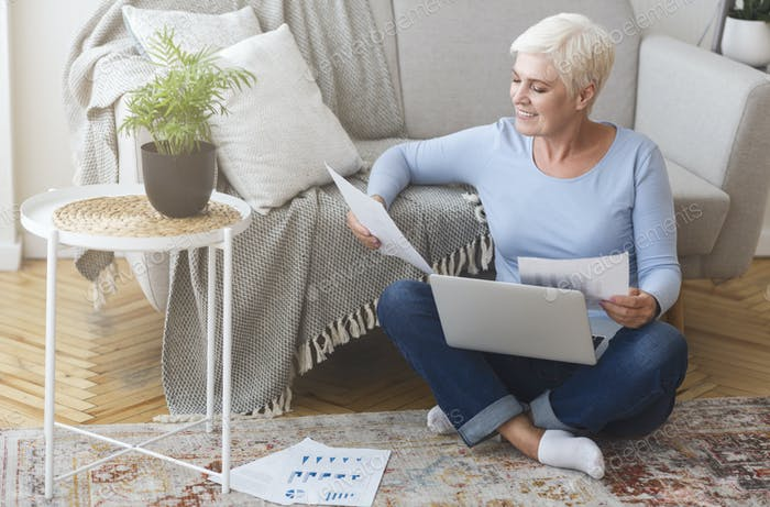 Senior financial consultant working with laptop at home