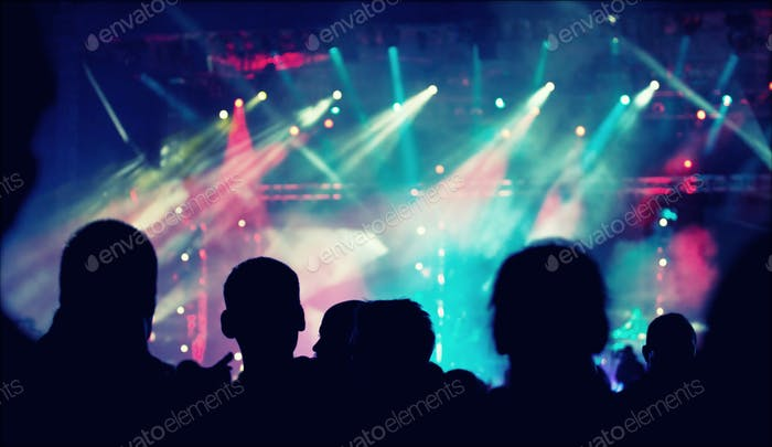 Cheering crowd in front of stage lights - retro photo