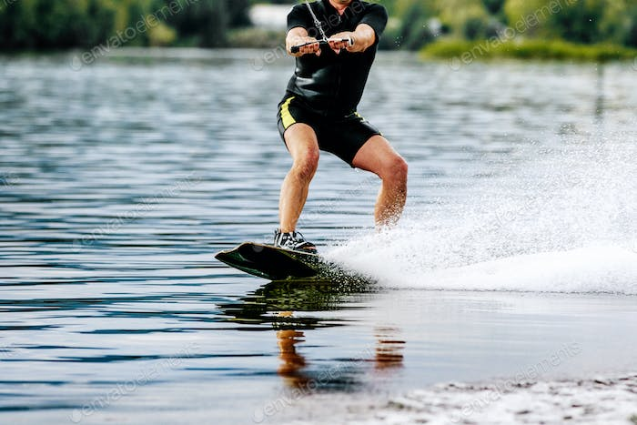 Man rides a wakeboard