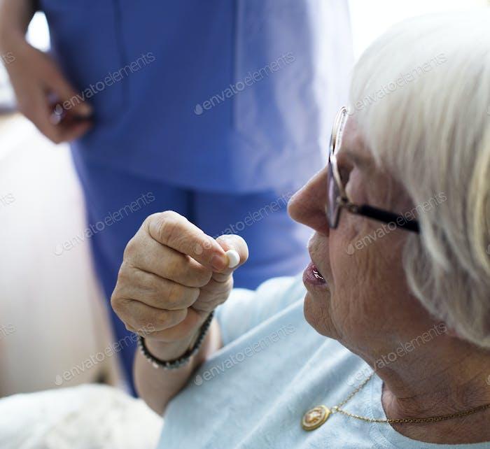 Senior woman taking a medicine