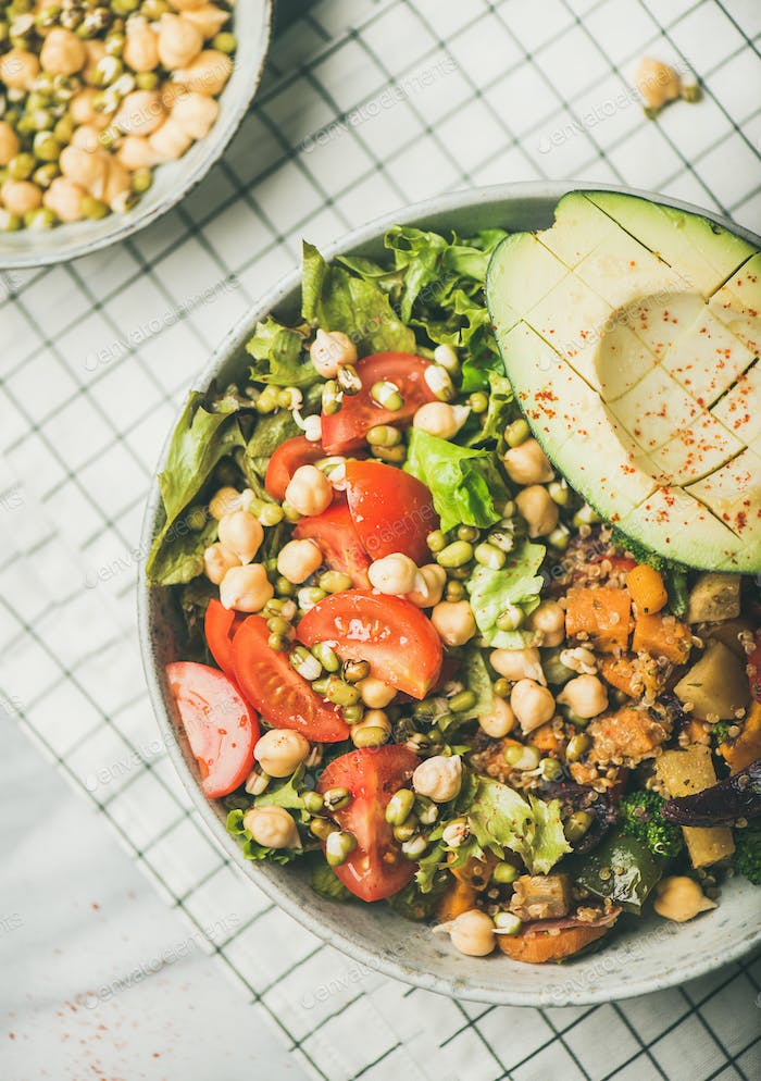 Vegan bowl with avocado, grains, beans and vegetables