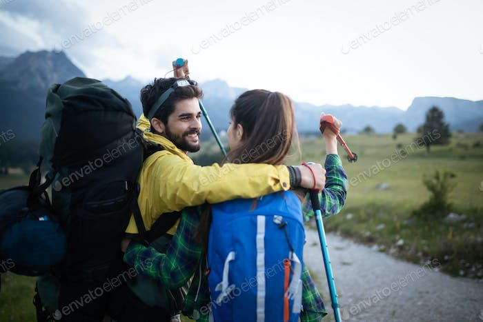 Portrait of happy young couple having fun on their hiking trip