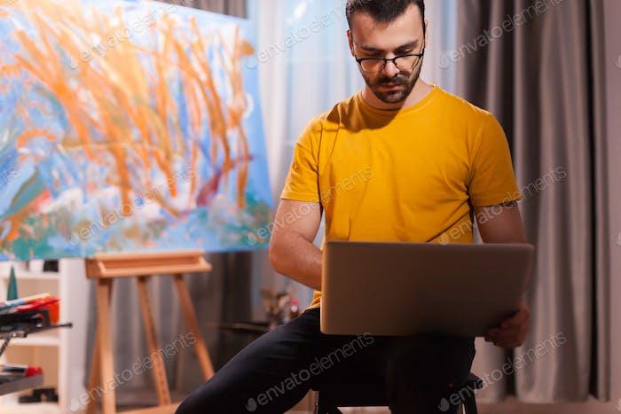 Painter using laptop