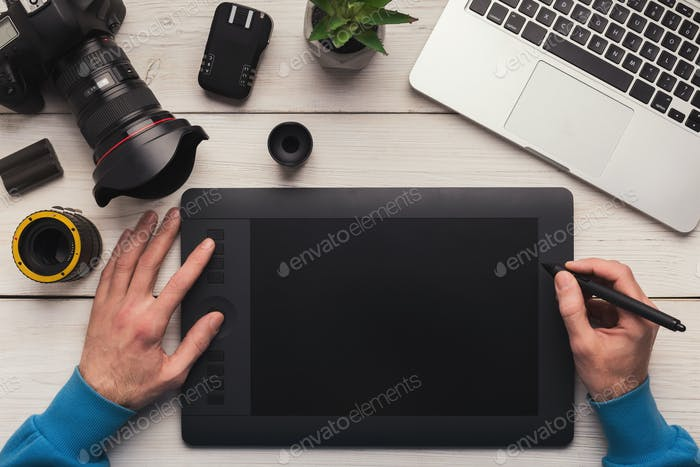 Designer hand working with graphic tablet