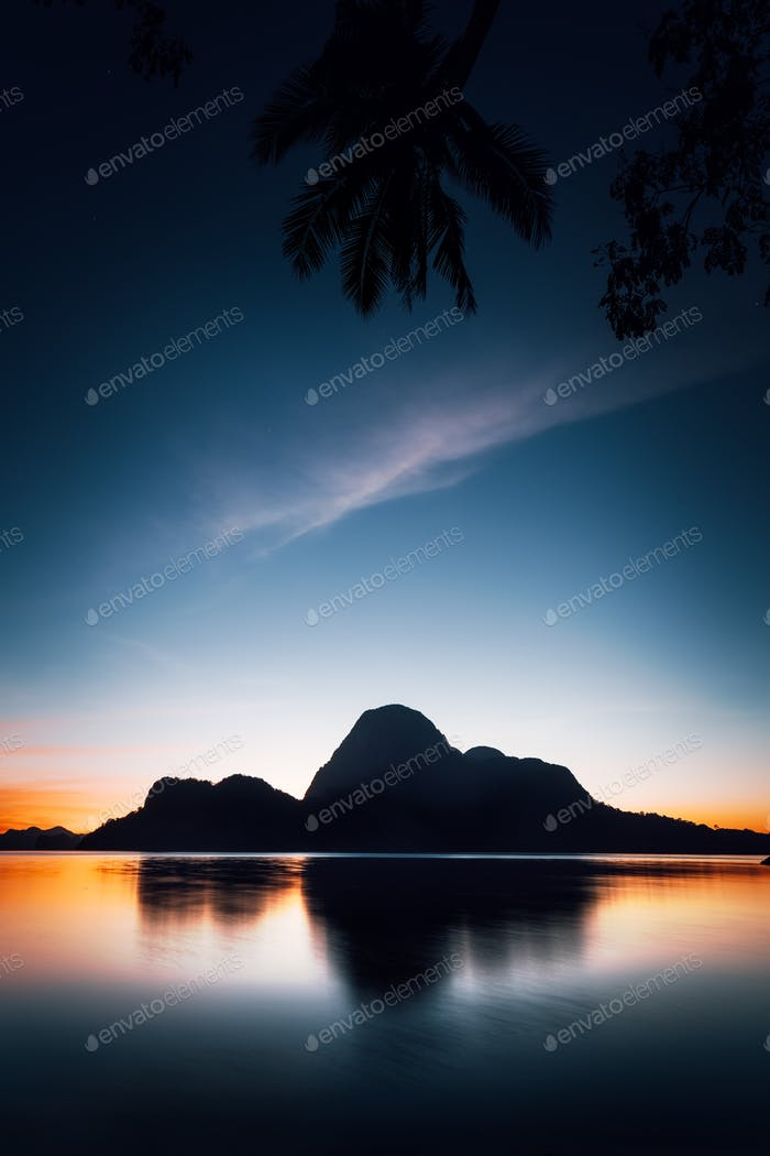 El Nido silhouette of beautiful Cadlao Island in dusk light after sunset in Palawan Island