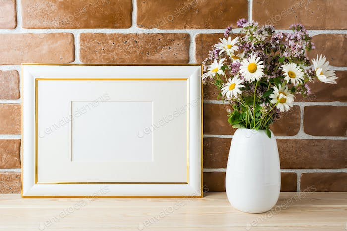 Gold decorated landscape frame mockup with wildflowers bouquet i