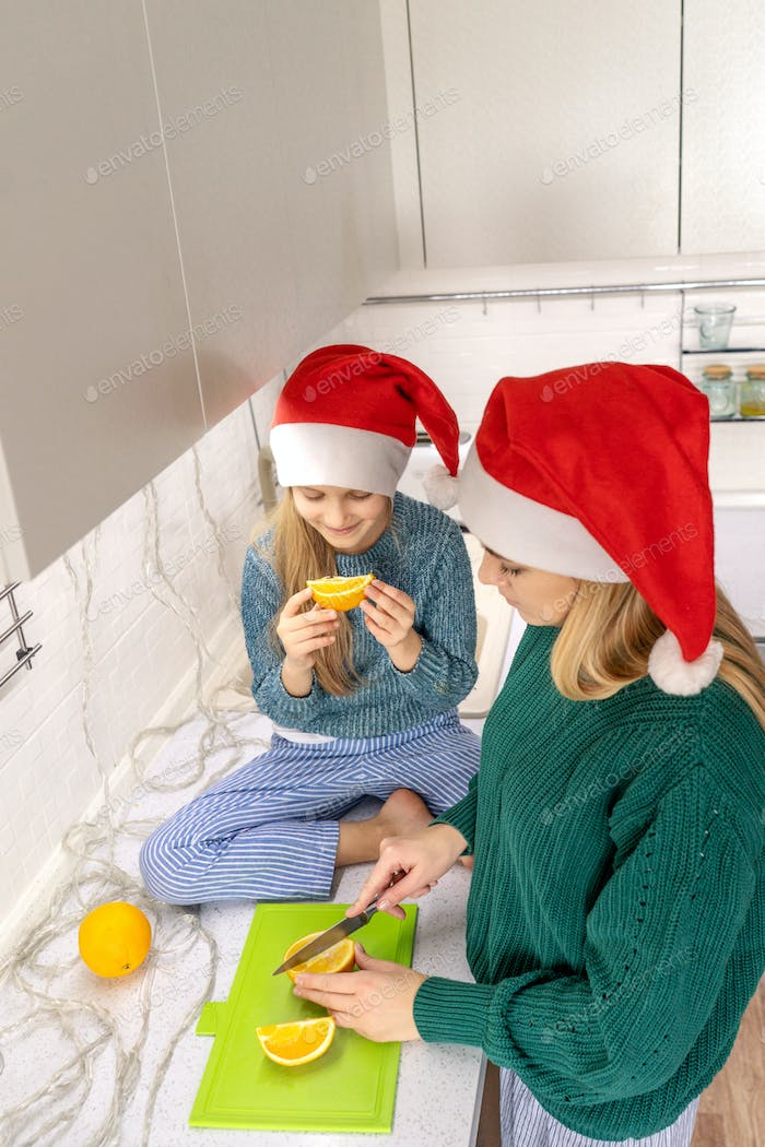 little girl and mother in Santa hats