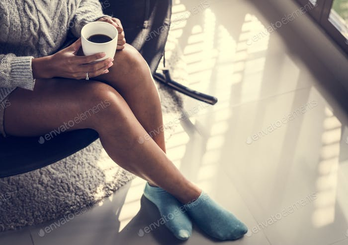 Woman having a warm cup of coffee