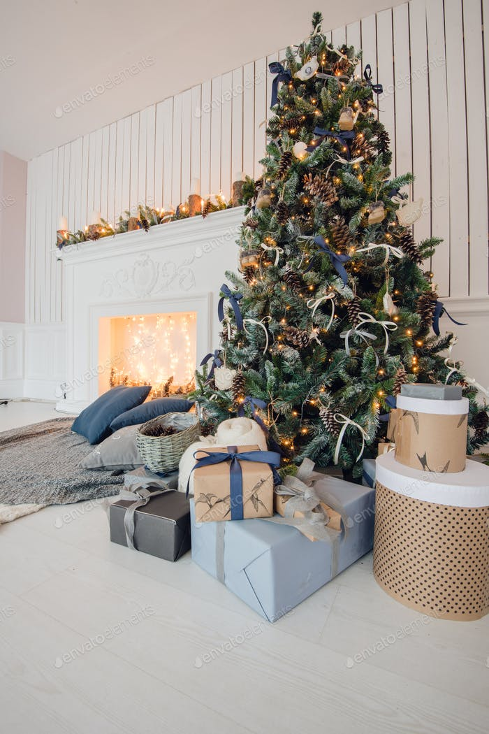 Stylish Christmas interior decorated in gray colors. Comfort home.