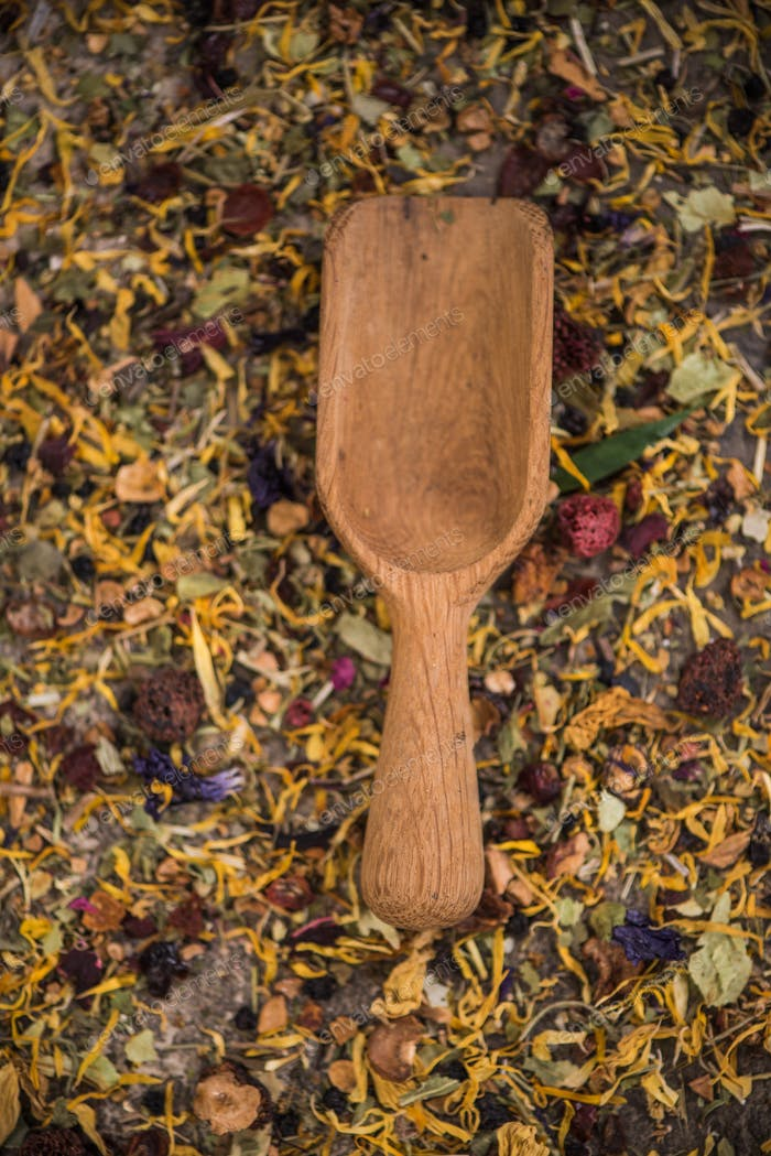 Wooden spoon on loose herbal tea