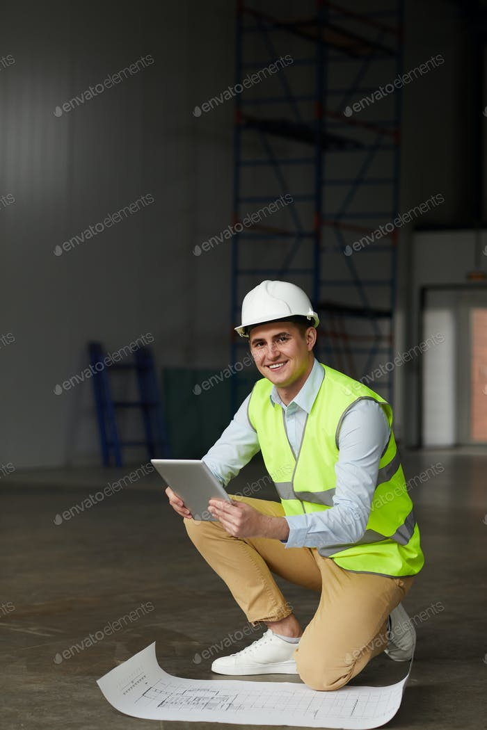 Engineer working with construction plan
