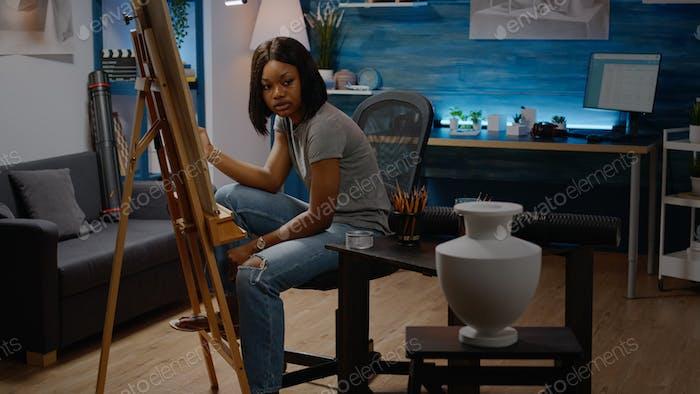 Artist of african american ethnicity reproducing vase design
