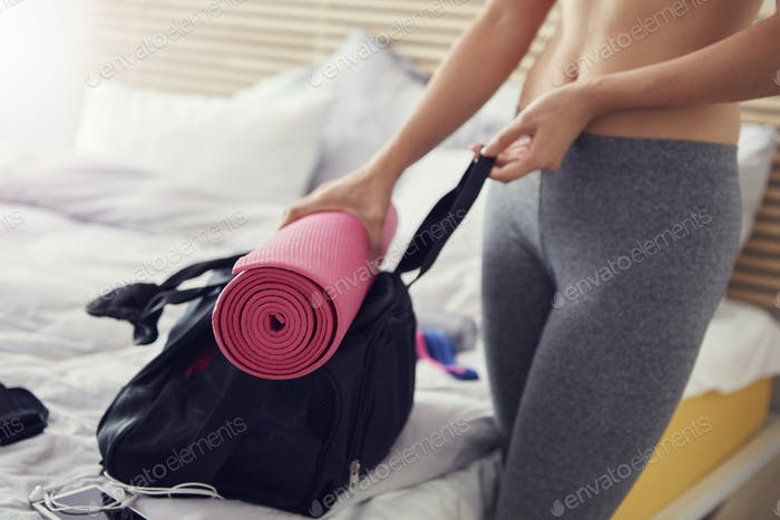 Woman preparing gym bag for active day