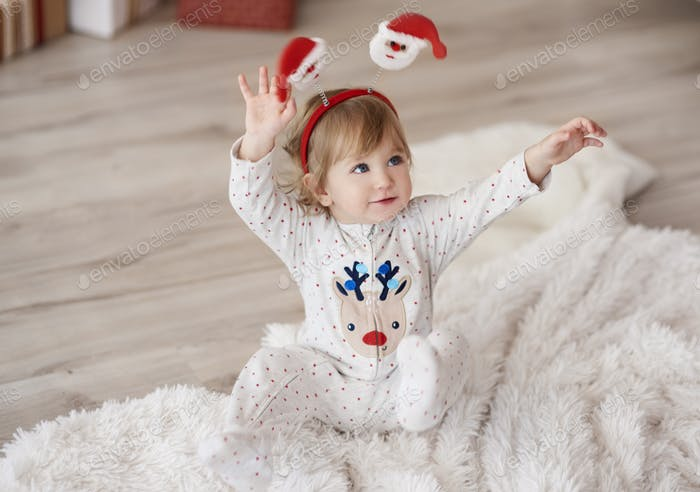 Cute baby with hands raised