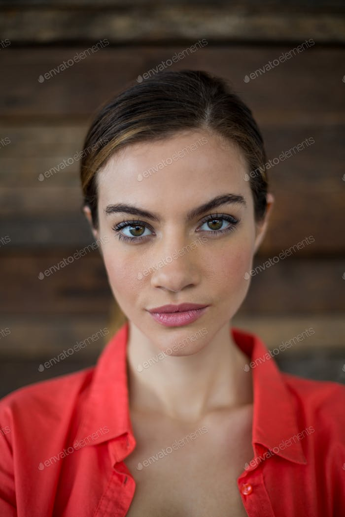 Confident female business executive standing in office