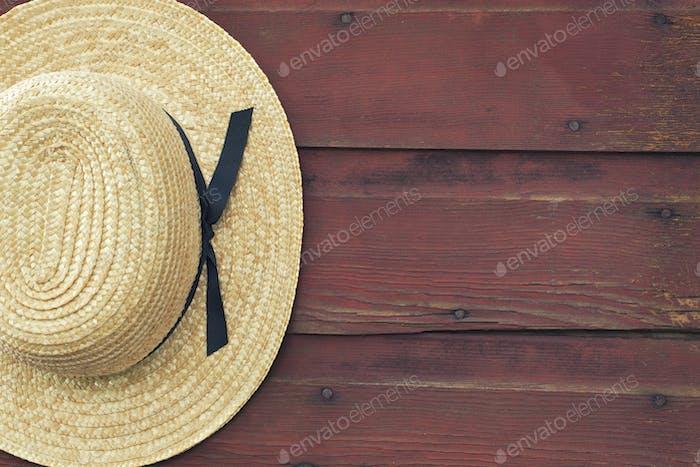 Amish Straw Hat on Old Wood Door