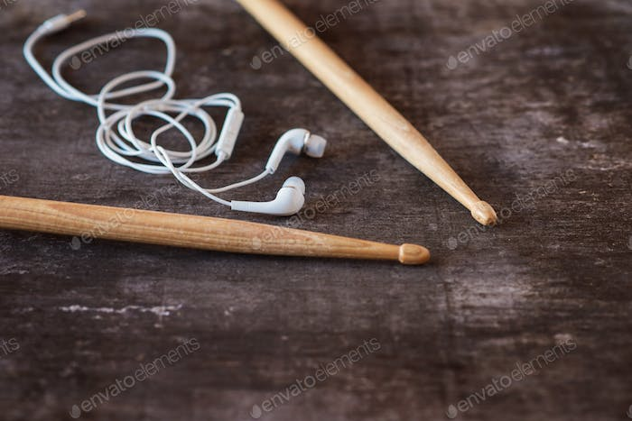 Drumsticks and earphones