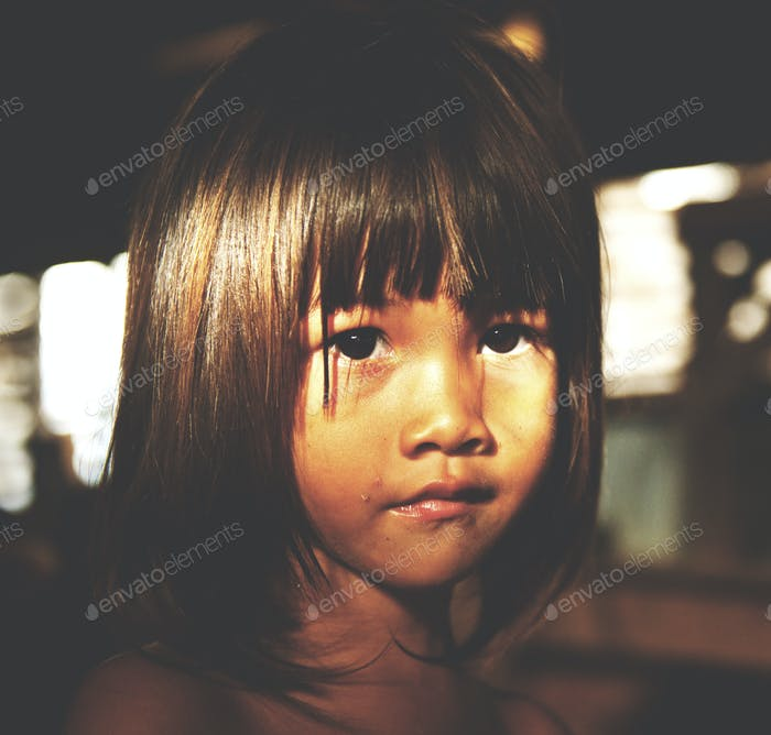 Little girl staring at the camera Cute Innocence Concept