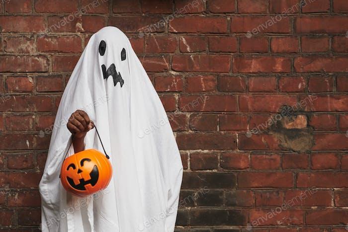 Kid Dressed Up As Ghost
