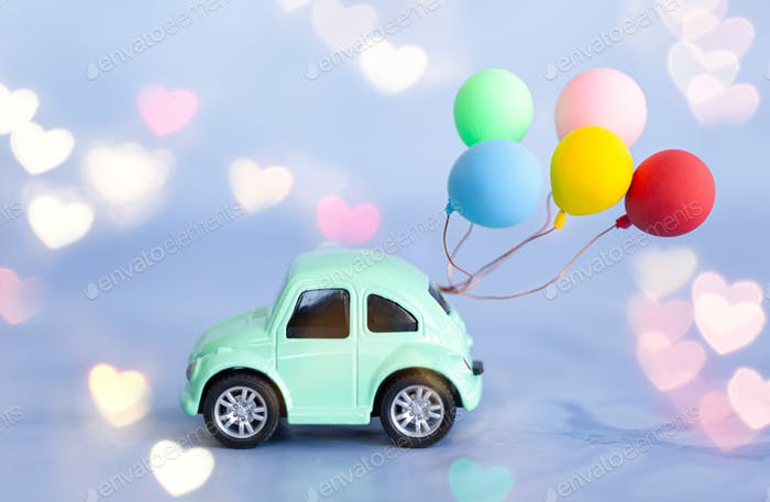 Toy car with balloons