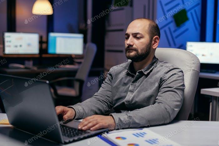 Caucasian entrepreneur working on deadline
