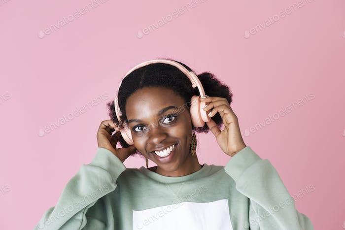 Pink headphones on pink