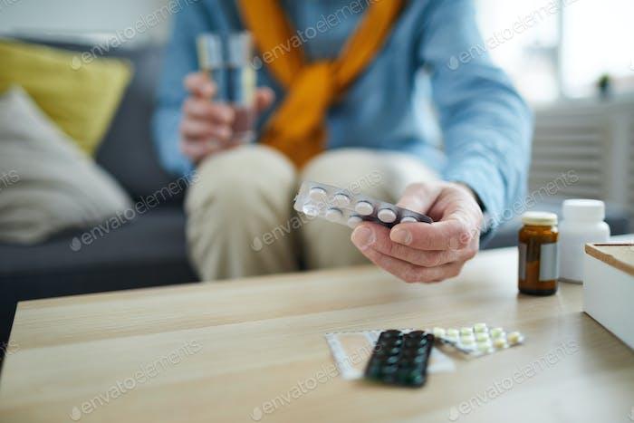 Mature Man Taking Pills