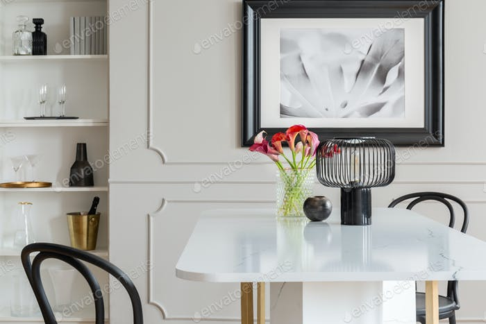 Black Lamp And Flowers On Table In White Elegant Dining Room Int