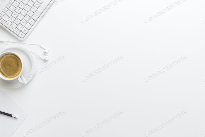 Keyboard With Coffee Cup And Earphones On White Desk