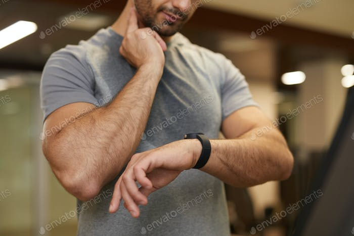 Man Checking Pulse during Workout