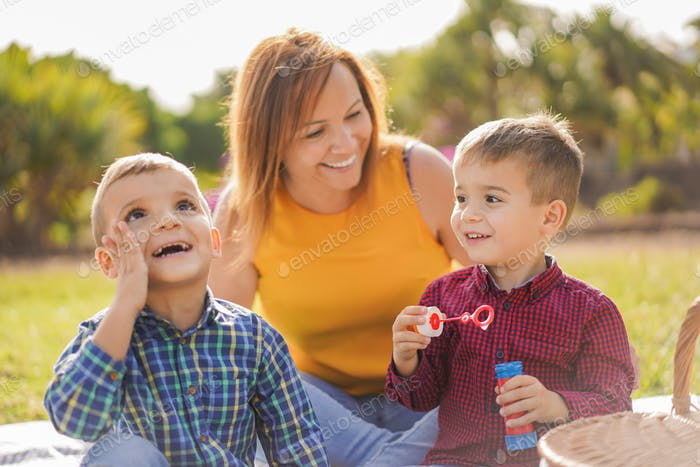 Happy family enjoy day in a nature park with pic nic - Mother and child love