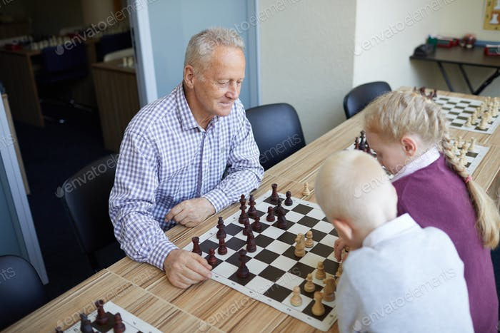 Grandfather playing against grandkids