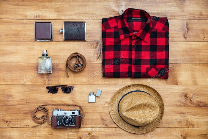 Travel concept shirt, camera, hat, flask, lighter, eyeglasses, belt,wallet