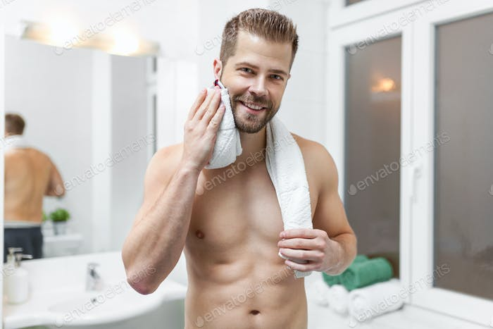 Morning hygiene, Man in the bathroom looking in mirror