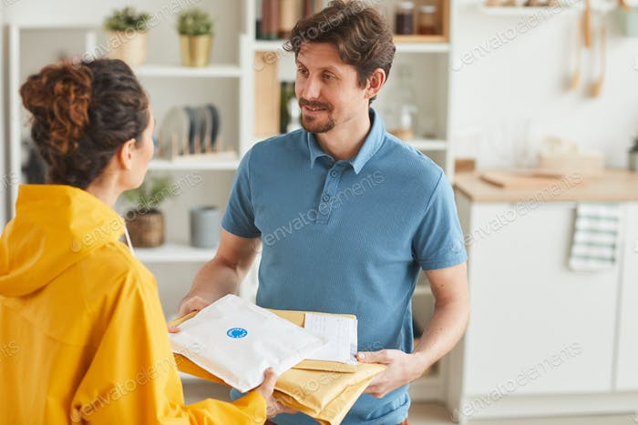 Woman delivering mails to man
