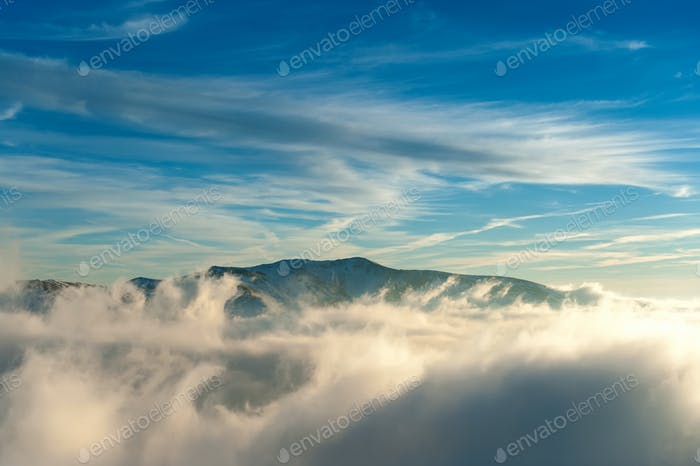 Winter mountain landscape with fog