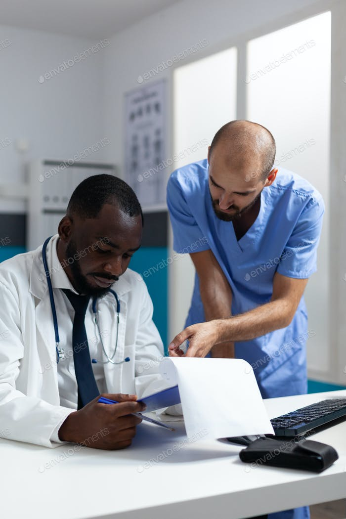 African american physician doctor analyzing clinical documents