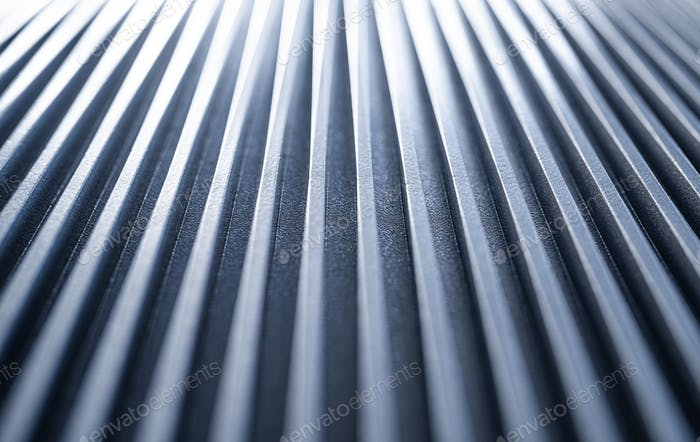 Close-up of an iron corrugated surface of a device