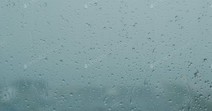 Heavy raining outside, rain on the window glass