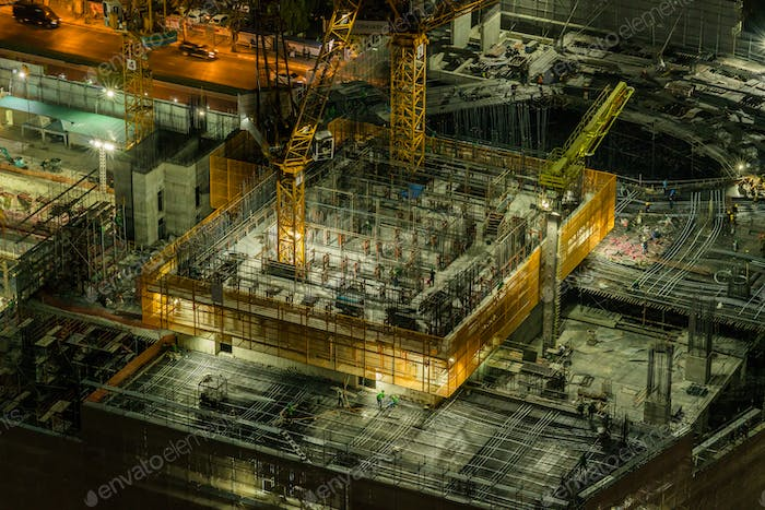 worker are working in Under construction and Cranes built the building in downtown of bangkok