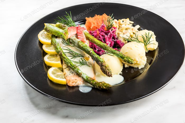 Grilled salmon with asparagus and potatoes, restaurant serving p